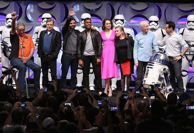 Peter Mayhew (Chewbacca) with a lightsaber walking stick, Mark Hamill (Luke Skywalker), Oscar Isaac (Poe Dameron), John Boyega (Finn), Daisy Ridley (Rey), Carrie Fisher (Princess Leia), Anthony Daniels (C-3PO), JJ Abrams and a fully-mobile R2-D2!