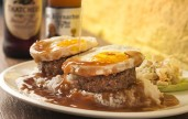 The Loco Moco is a Hawaiian comfort food comprising ribeye patties with eggs over rice, and drowned in brown gravy