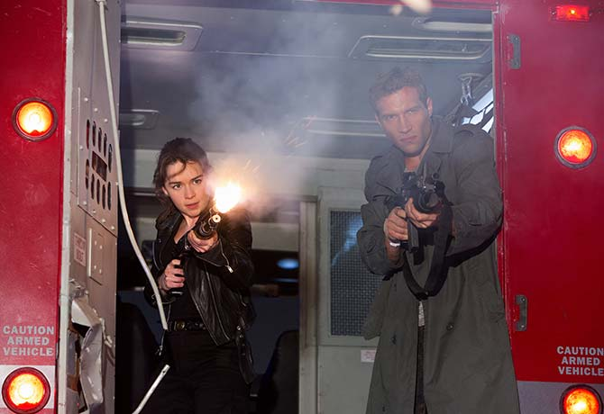 """Kyle Reese (right, Jai Courtney) goes back in time to fight against the Terminators with Sarah Connor (Emilia Clarke of """"Game of Thrones"""")"""