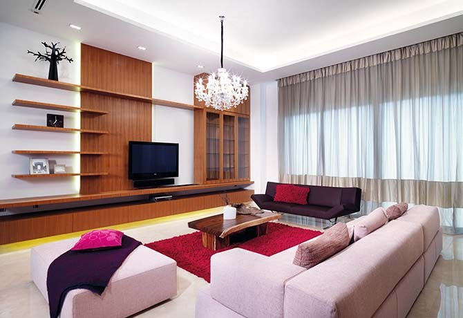 The timber-based feature wall in the living room commands attention.