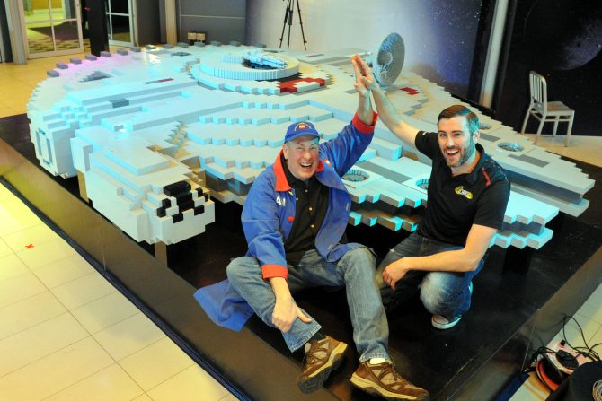 Dan and Chris Steininger elated at the completion of the LEGO replica of the Millennium Falcon