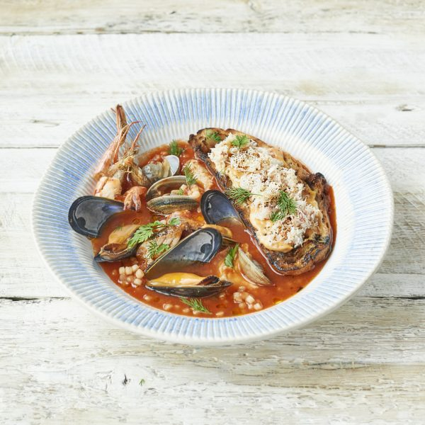 Venetian Fish Stew - Sustainable fish & shellfish cooked in a rich tomato & Fiano white wine sauce with fregola, crostini & crab aioli