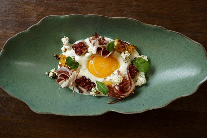 butter-poached-egg-yolk-grilled-spanish-octopus-corn-espuma-roasted-corn-popcorn-infused-with-lovage-jamon-iberico-bellota-micro-rocket
