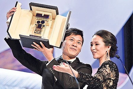 Anthony Chen Ilo Ilo Cannes Camera d'Or film festival winner Zhang Ziyi