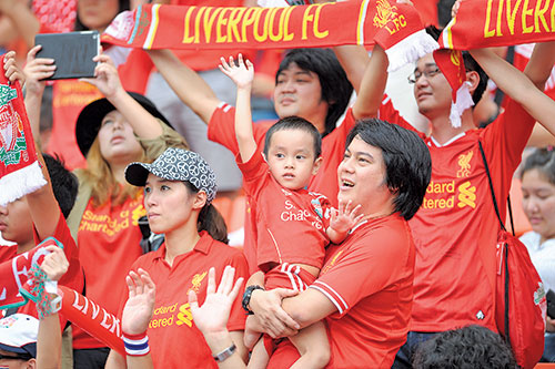 Liverpool fans are said to be among the best fans in the world, as evidenced here in a pre-season tour of Thailand Credit: photofriday / Shutterstock.com