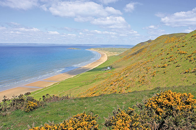 Rhossili Beach Bay in the UK features Jurassic terrain with stirring views