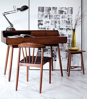 Study Buddy You'll be re-inspired to get back to work once you sit behind this  sleek desk. The slim pencil legs, gently curved profile and sturdy build are good enough reasons to stay at home and get work done.  Bowen writing desk, $939, from Commune