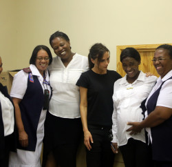 Victoria Beckham with staff from the Mother2Mother programme at the Delft Community Health Centre, Cape Town, South Africa. UNAIDS PICTURE BY: JENNIFER BRUCE.