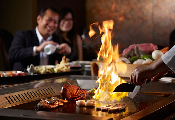 The Teppanyaki counter at Shima blazes as juicy morsels are about to be served