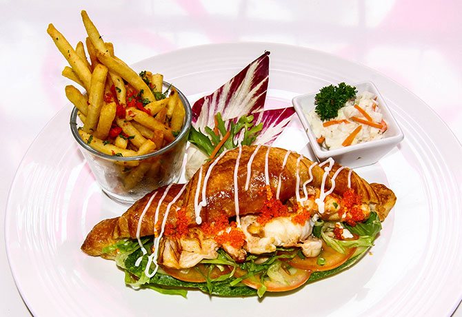 The juicy Cherie's Slipper Lobster Croissant is drizzled with refreshing sauce