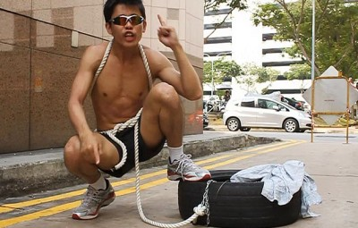 """""""Ah Siao"""" made headlines by running a marathon with a tyre strapped to his waist"""