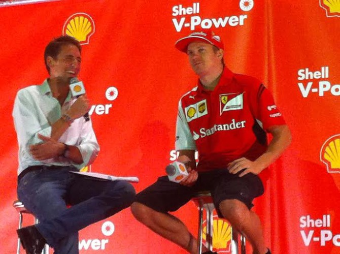 Caught in the act Räikkönen (right) smirks when he gets caught yawning on stage