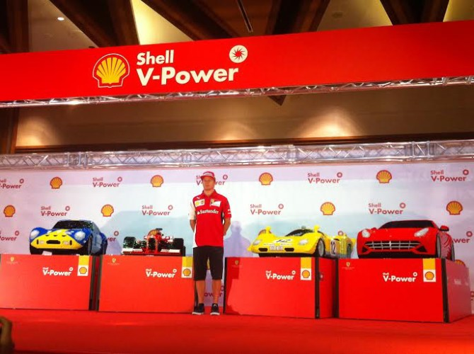 Power racer F1 World Champion Kimi Räikkönen with half-sized scale models of Ferrari racecars