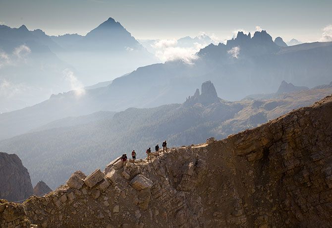 Climbers tread across the Monte Cristallo Ridge leading to the WWI tunnels