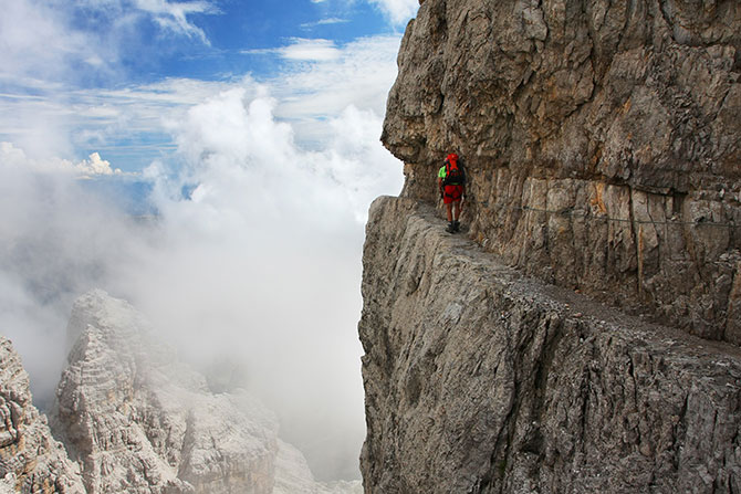 A climber edges across one of the difficult sections of the  Via Ferrata
