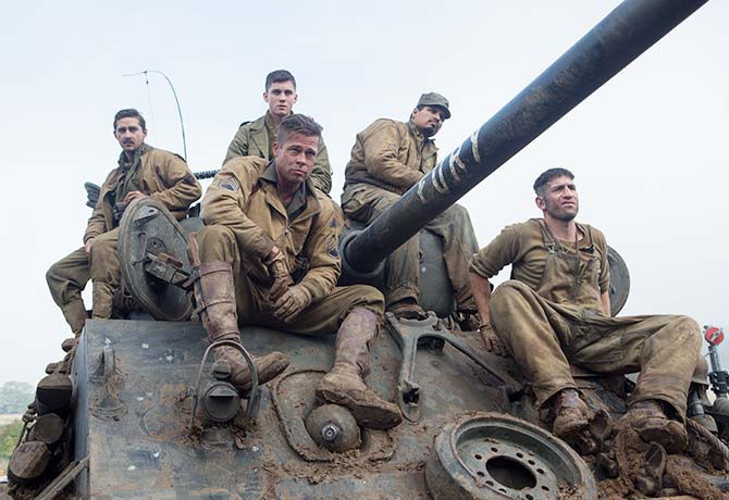 """Brad Pitt plays Sergeant Don """"Wardaddy"""" Collier (centre), with Logan Lerman as Norman Ellison (back) and Shia LaBeouf as Boyd Swan (back, left)"""