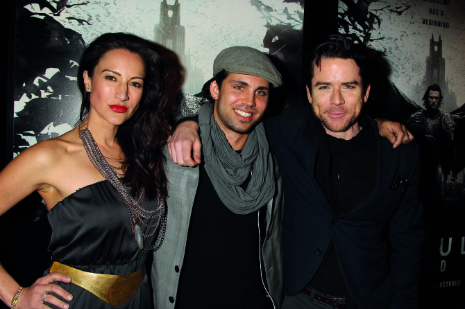 Actor Christian Campbell (right), wife America Olivo (left) and guest
