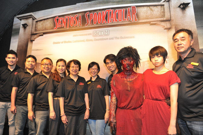 Directors Parkpoom Wongpoom (second from left) and Paween Purijitpanya (far left) with the Spooktacular team and the Alone twins