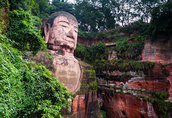 One must get up close to truly appreciate the  Giant Buddha – every detail carved over 90 years is remarkable, including the coiled hair comprising 1,021 masterfully-embedded buns that appear an undivided whole
