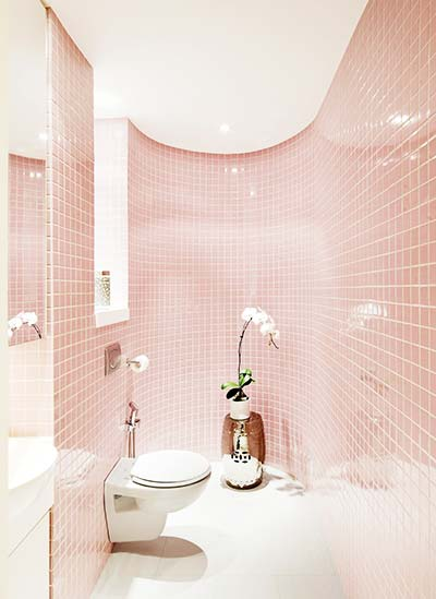 A cheerful punch of colour reveals itself in the bathroom