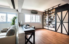 Bookshelves built against the wall double as a focal point