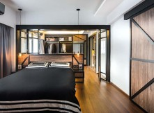 Two rooms have been combined to create the master bedroom, complete with a walk-in closet