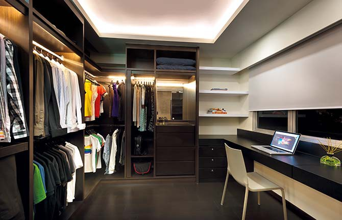 The room adjacent to the master bedroom has been converted into an efficient walk-in-wardrobe-cum-study area