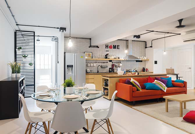 Walls were torn down, rooms were combined and the layout was drastically altered to achieve this bright and spacious interior – the living area, dining room and kitchen all sit comfortably next to one another