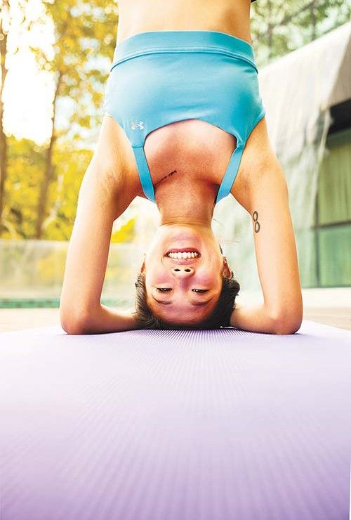 Being upside down keeps Mandy grounded <br/><br/>Top: Under Armour Eclipse Bra in Island Blue, $59