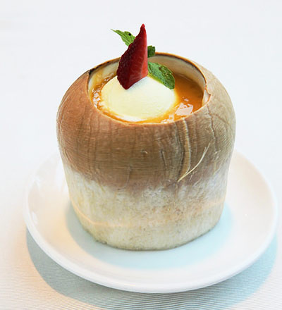 Aloe-vera with sago topped with ice cream in whole coconut