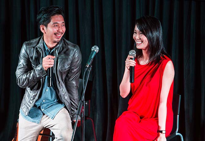Joanne Peh chats with director Randy Ang (left) about filming 1965 while being newly pregnant