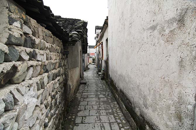 Old alleyways contrasted against black-tiled roofs are classic features of an old town
