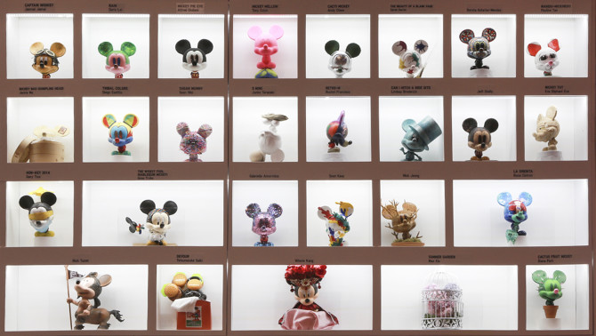 A selection of the Mickey 100 miniature statues in a wall display from the pop-up store