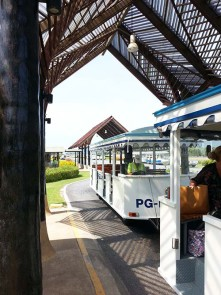 Charming trolleys ferry passengers from the planes to the terminals at Samui Airport