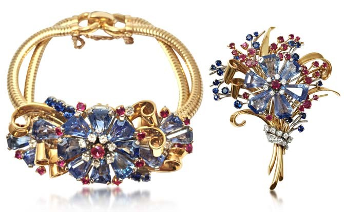 A retro Sapphire and Ruby Floral Spray Bracelet (left) and a Sapphire and Ruby Floral Spray Brooch,  by Tiffany & Co., circa 1940s. From Revival Vintage Jewels and Objects.