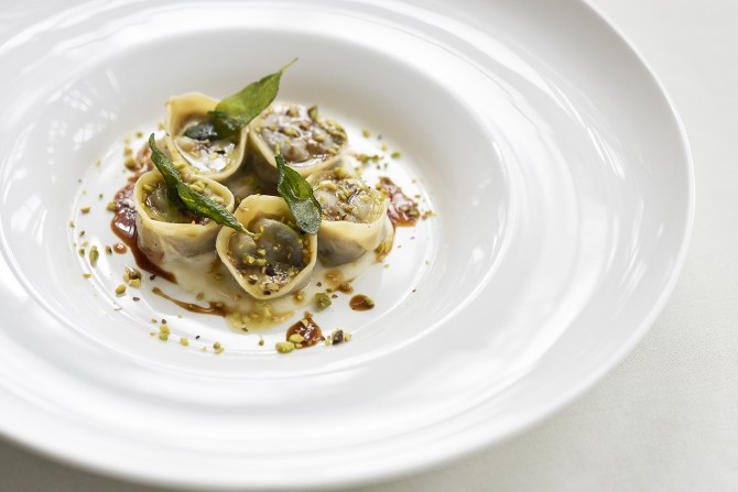 agnolotti stuffed with 12 hours marinated beef oxtail celery root puree pistachio nuts